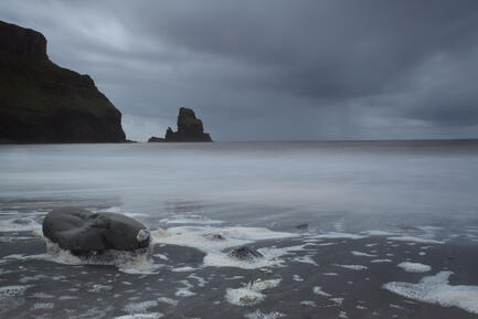 Talisker Beach with rain an incoming tide